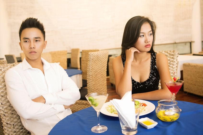 asian couple on a boring date